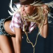 Beautiful rodeo girl in sheriff hat — Stock Photo