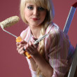 Beutiful girl with the roller — Stock Photo