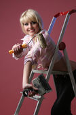 Nice girl with the roller — Stock Photo
