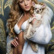 Beautiful blonde with small dog — Stock Photo