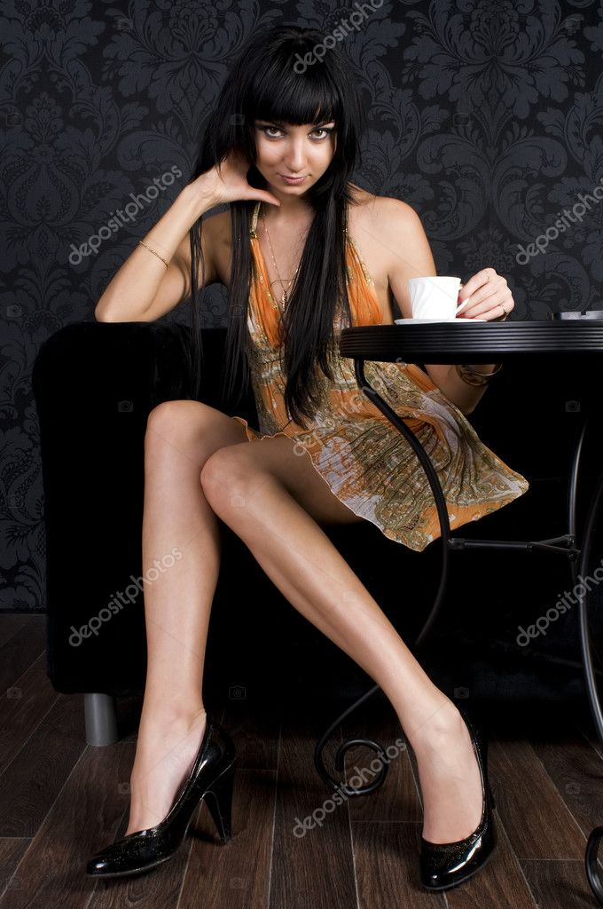 Beautiful girl is sitting in the cafe and  drinking coffe  Stock Photo #1418676