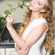 Blonde with white rose — Stock Photo