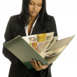 Businesswoman is reading the big book — Stock Photo #1616261