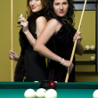 Two girls are playing billiards — Stock Photo #1616521