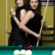 Two girls are playing billiards — Stock Photo
