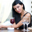 Woman in restaurant - Stock Photo