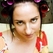 Stock Photo: Woman with curlers