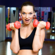 Woman with dumbbells - Photo