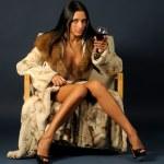 Woman in furs witn wine. — Stock Photo
