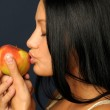 Beautiful exotic woman with apple — Stock Photo #1617716