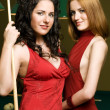 Stock Photo: Two girls are playing billiards