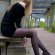 Young blonde in the garden - Foto Stock