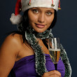 Woman drinking champagne into Christma — Stock Photo