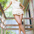 Stock Photo: Blonde on porch