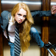 Young woman in lift — Stock Photo