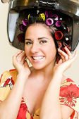 Woman with curlers — Stock Photo