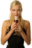 Blonde girl is drinking wine — Stock Photo
