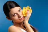 Beautiful girl with yellow orchid — Stock Photo