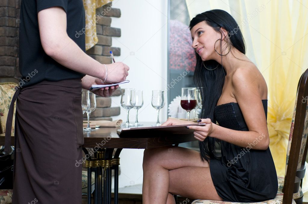 Beautiful woman making the order in restaurant — Stock Photo #1616252