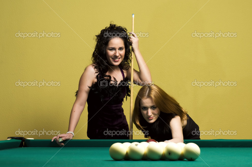 Two beautiful girls are playing billiards  Stock Photo #1616583