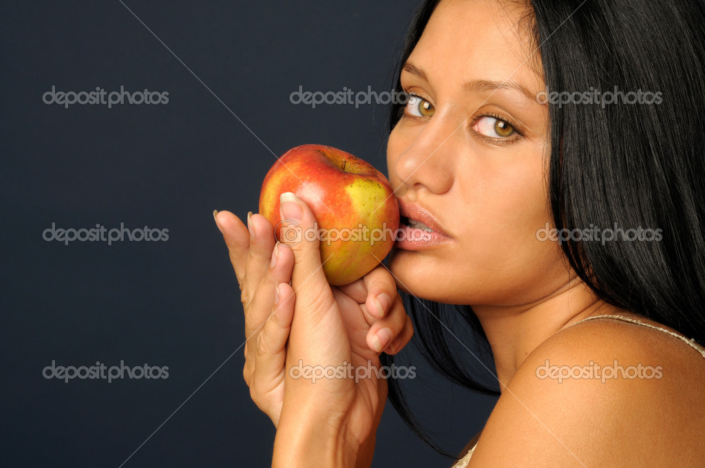Beautiful exotic woman with apple — Stock Photo #1618054
