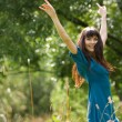 Happy girl jumps on a green glade — Stock Photo