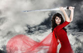Young beautiful girl with a sword — Stock Photo