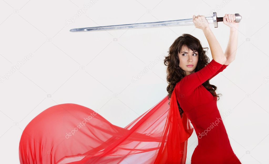 Young beautiful girl with a sword in hands — Stock Photo #1418653