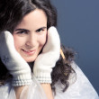 Стоковое фото: Beautiful girl in white mittens.