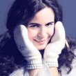 Foto Stock: Beautiful girl in white mittens.
