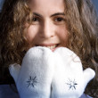 Beautiful girl in white mittens. - Stock Photo