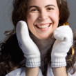 Beautiful girl in white mittens. — Stockfoto