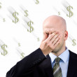 Businessman  suffers from a headache - Stock Photo