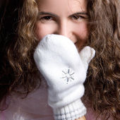 Beautiful girl in white mittens. — Stock Photo