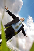 Happy businessman embraces the sky — Stock Photo
