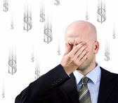 Businessman suffers from a headache — Stock Photo