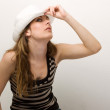 Young beautiful girl in a white hat — Stock Photo #1433814