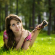 Young beautiful girl on a grass — Stock Photo
