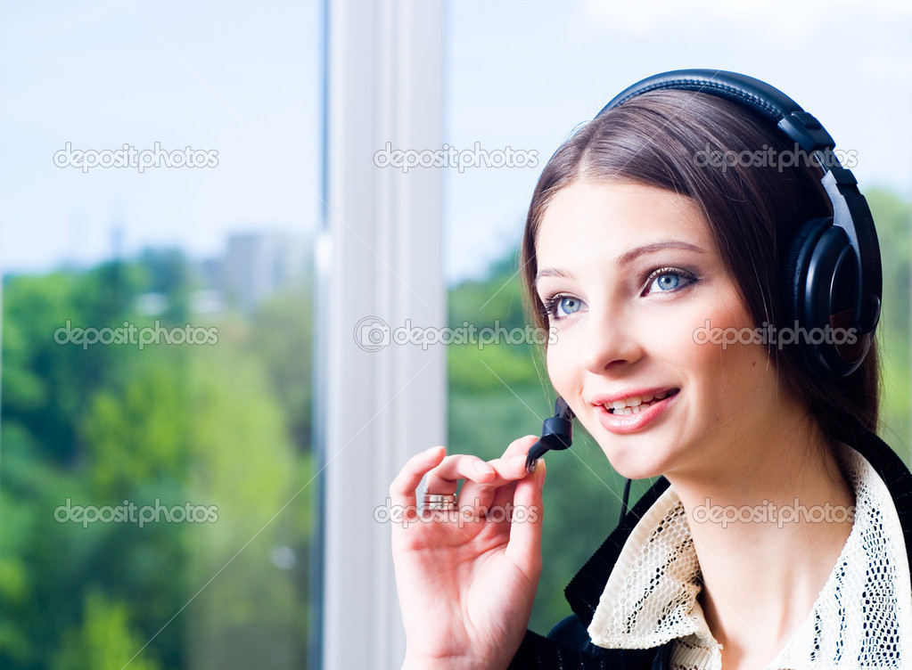 Support woman in headphone looking forward — Stock Photo #1435662