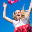 Foto Stock: Happy jumping girl