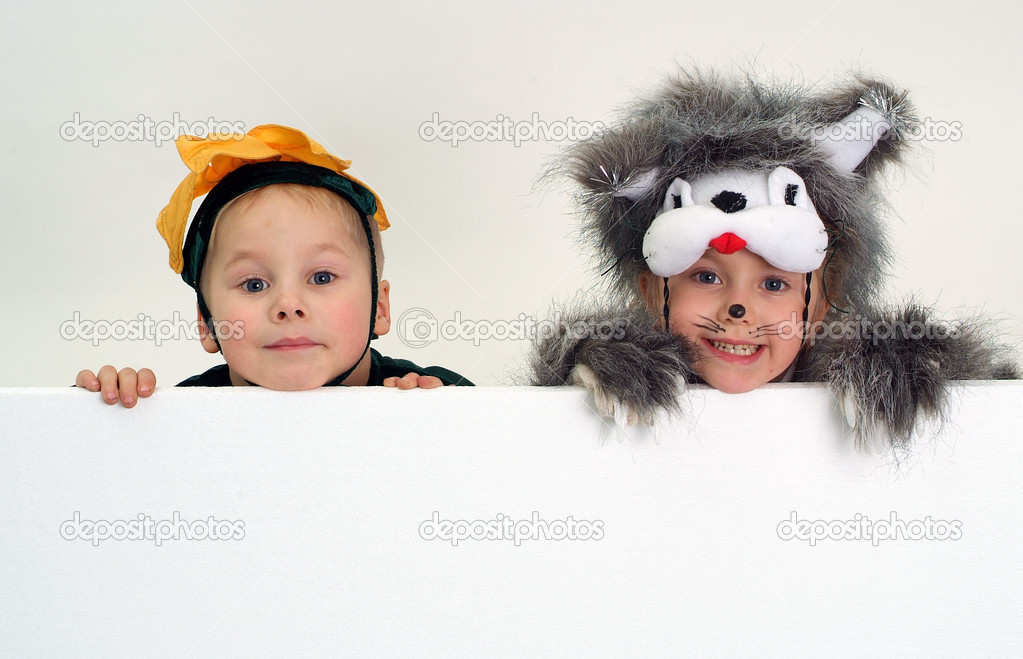 Funny kids faces above big blank sheet of paper  Stock Photo #1608029