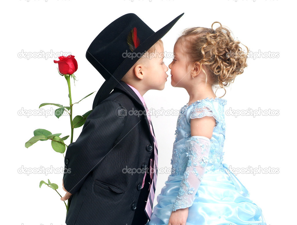 Little pretty boy with rose kisses girl in blue dress  Stock Photo #1608054