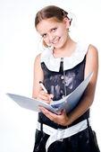Writing schoolgirl — Stock Photo