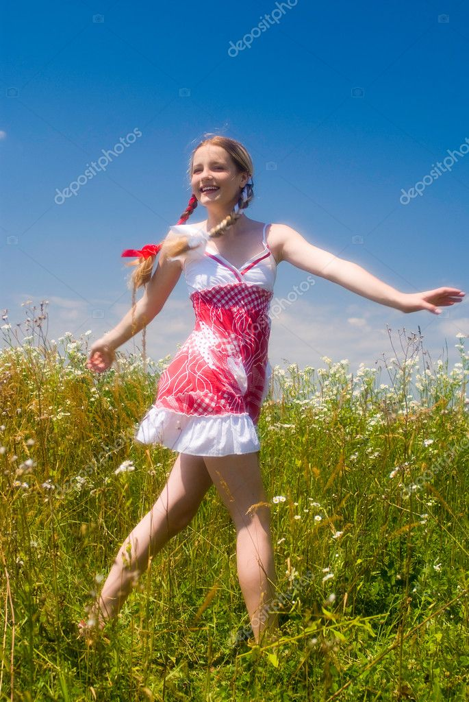 Girl enjoying summertime outdoor. Soft focus lens — Stock Photo #1723306