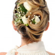 Wedding coiffure with white roses — Stock Photo