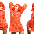 Baby doll expressive girl in red wig — Stock Photo