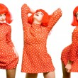 Baby doll expressive girl in red wig - Stock Photo