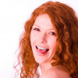 Redheaded girl showing her tongue — Stock Photo #1746657