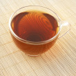 Glass cup of tea on wooden background — Stock Photo