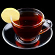 Glass cup of tea with lemon isolated — Stock Photo #1419770